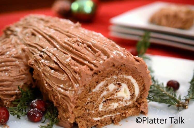 A close-up of a yule log cake.