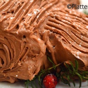 A close up of a chocolate yule log.