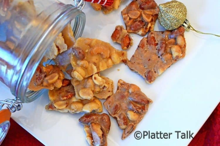 Peanut brittle on a white platter.