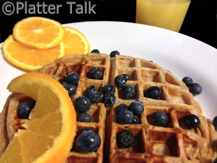a waffle with blueberries on top of it