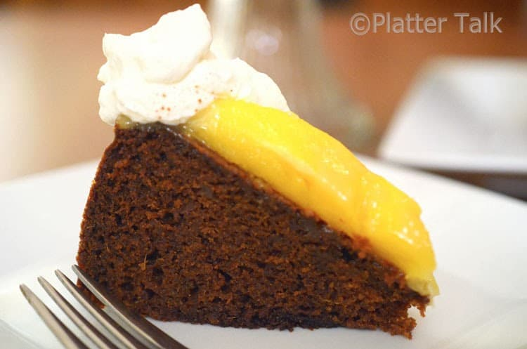 a slice of ginger cake with mango