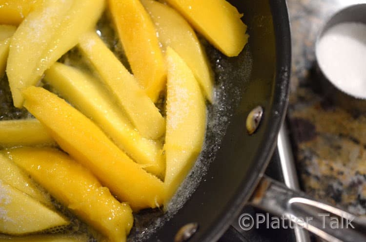 slices of mango in a pan