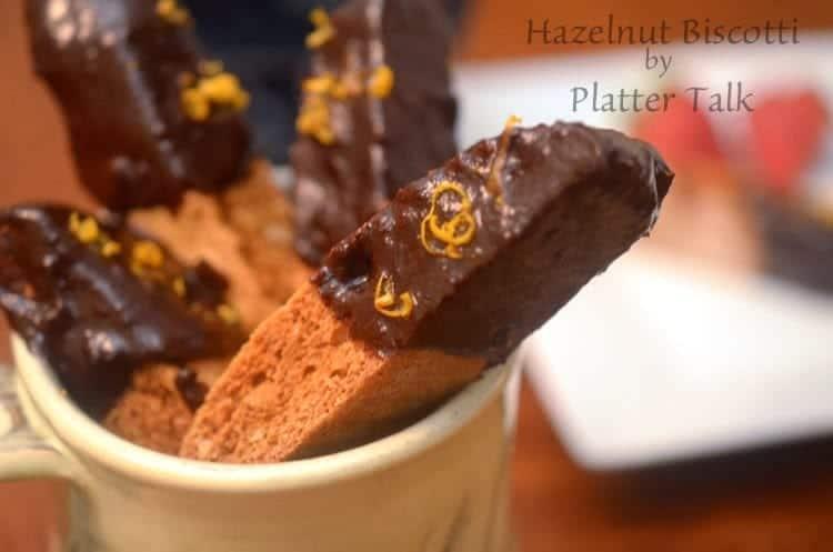 A cup full of hazelnut biscotti.