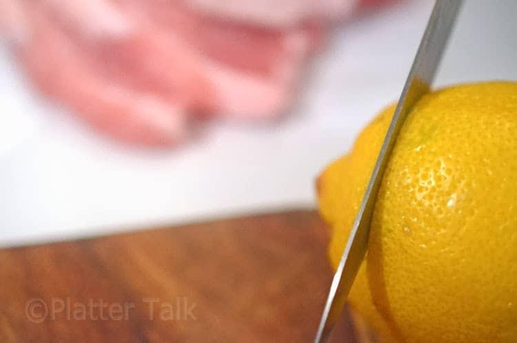 a lemon getting sliced