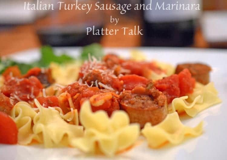 A close up of a plate of pasta with Sausage