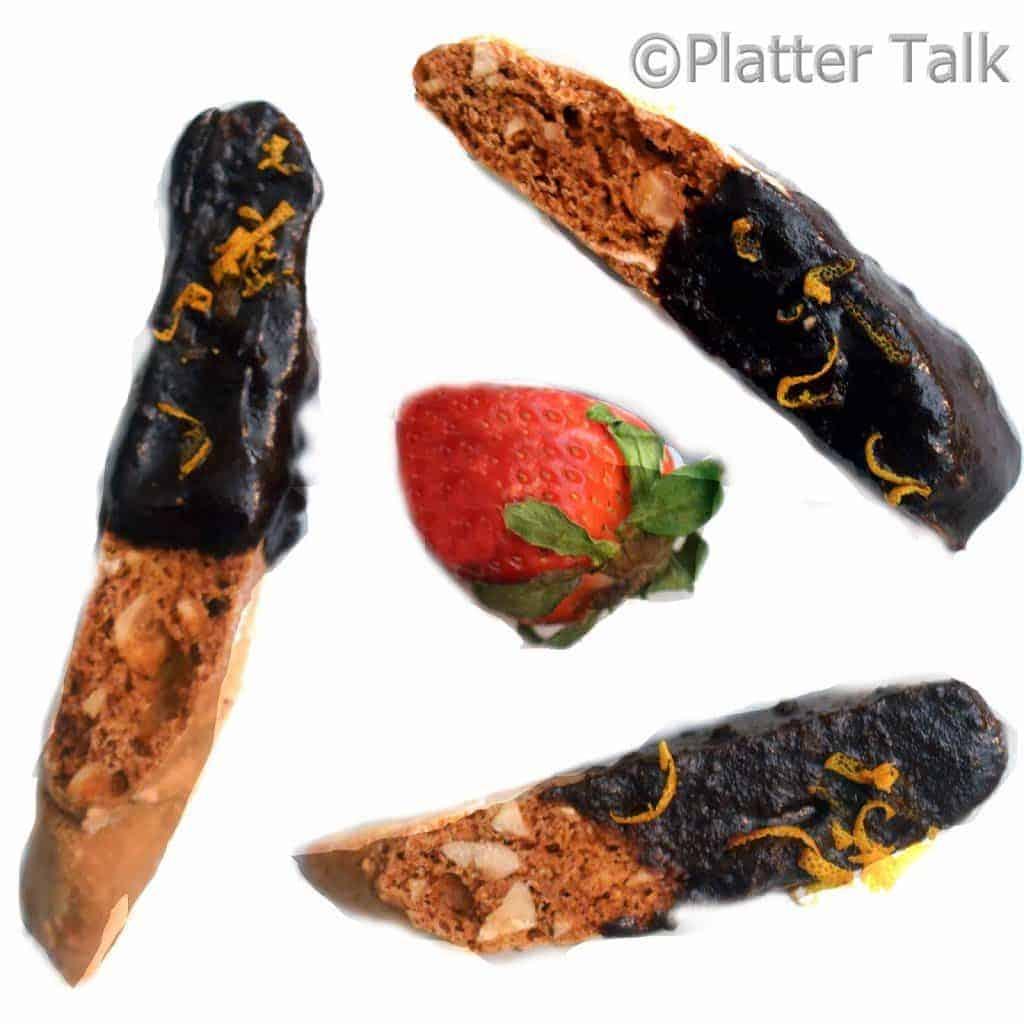 three hazelnut biscotti with a strawberry