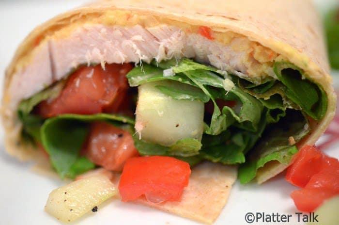 a healthy turkey wrap on a plate
