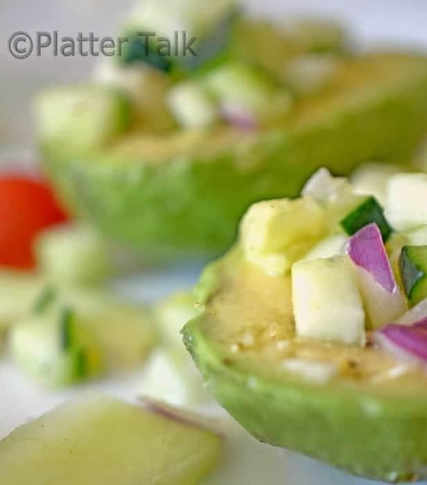 A close up of cuke salad, with avocado
