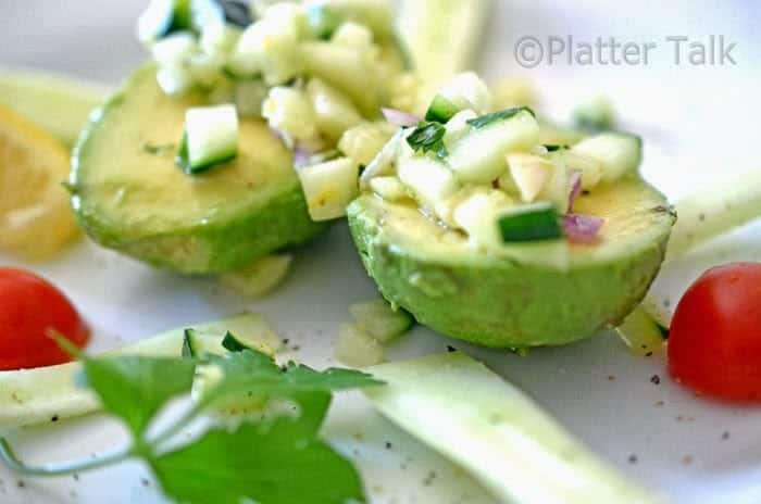 Salad atop split avocado with cilntro