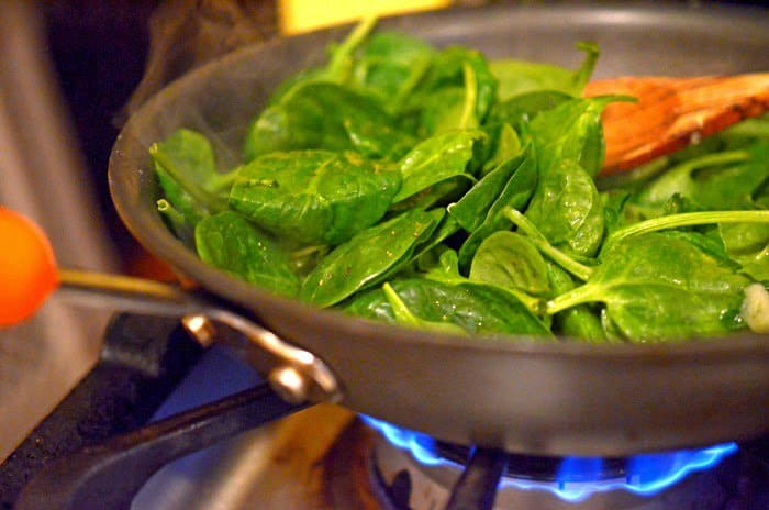 Wilted spinach is a great side for spinach and feta chicken rollups.