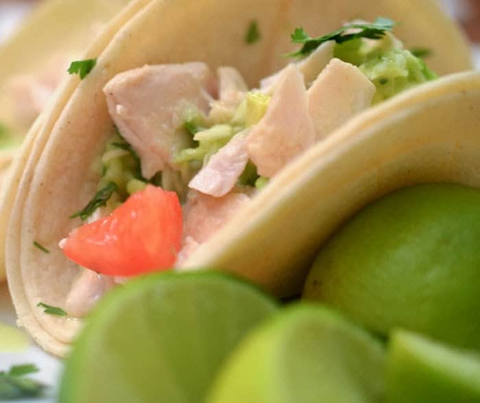 Simple fish tacos with tomato, slaw and lime.
