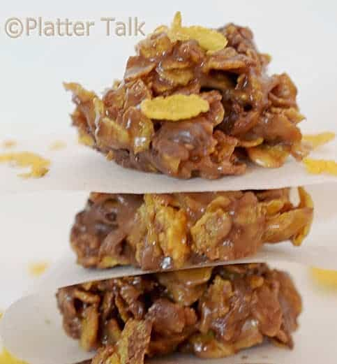 A stack of three Peanut Butter and Chocolate Cornflake Cookies