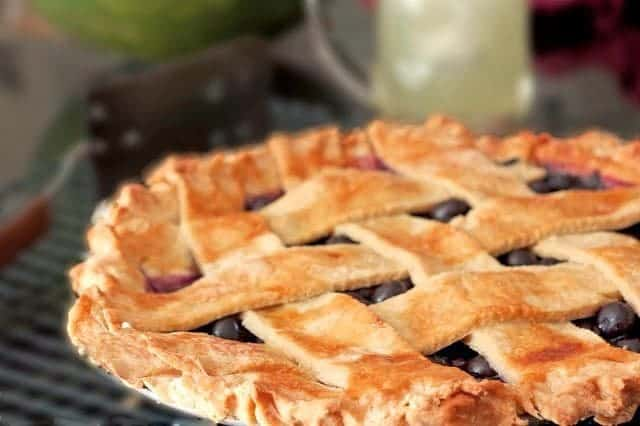 a blueberry pie on a plate