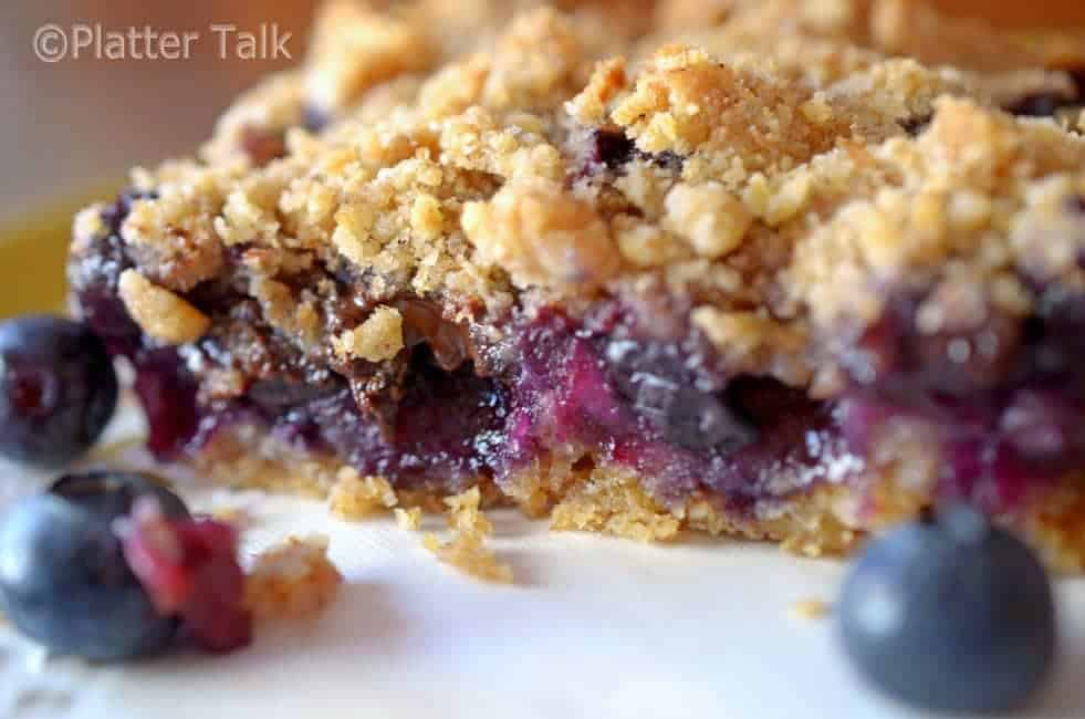 A close-up of a blueberry crumb bar.