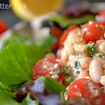 a close up of a white bean cherry tomato salad