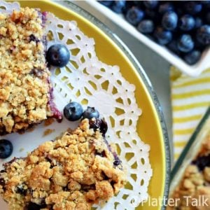 a plate of blueberry crumb bars.