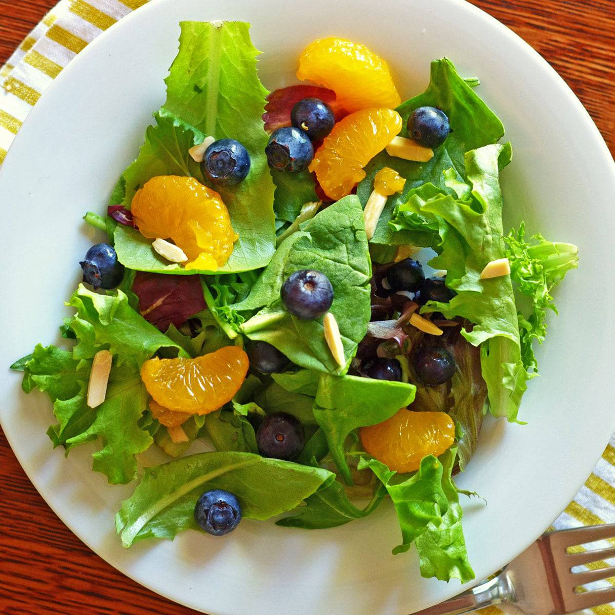Plate of mandarin orange salad with blueberries.