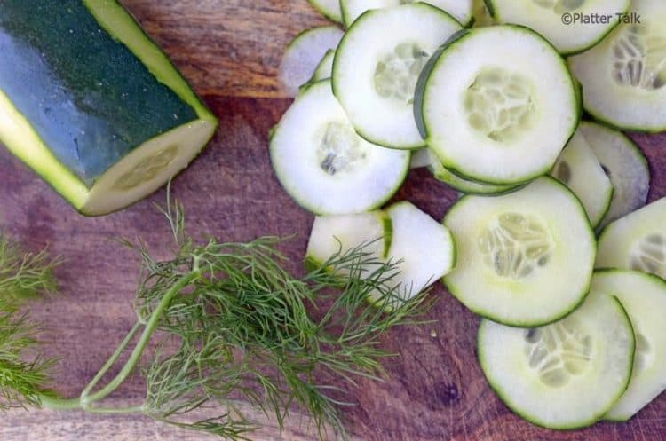 cucumber slices on a cutting board.