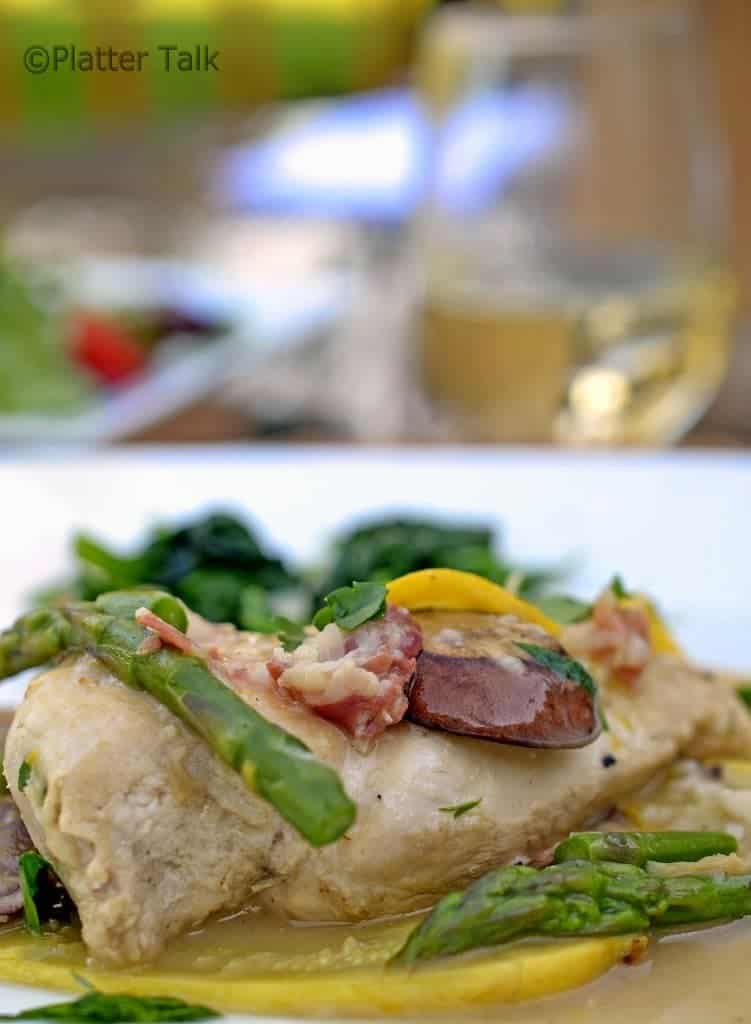 Chicken on a plate with asparagus.