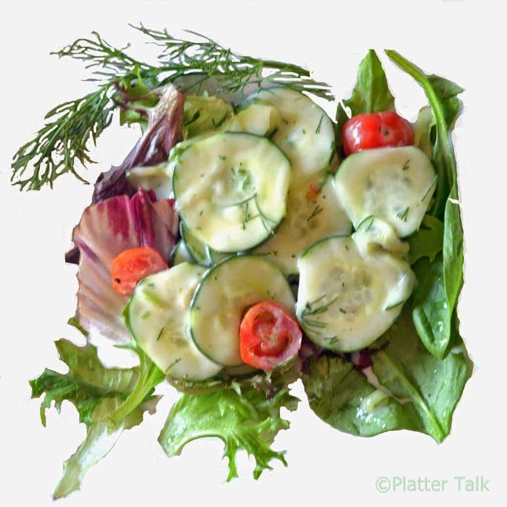 A close-up of a cucumber salad.