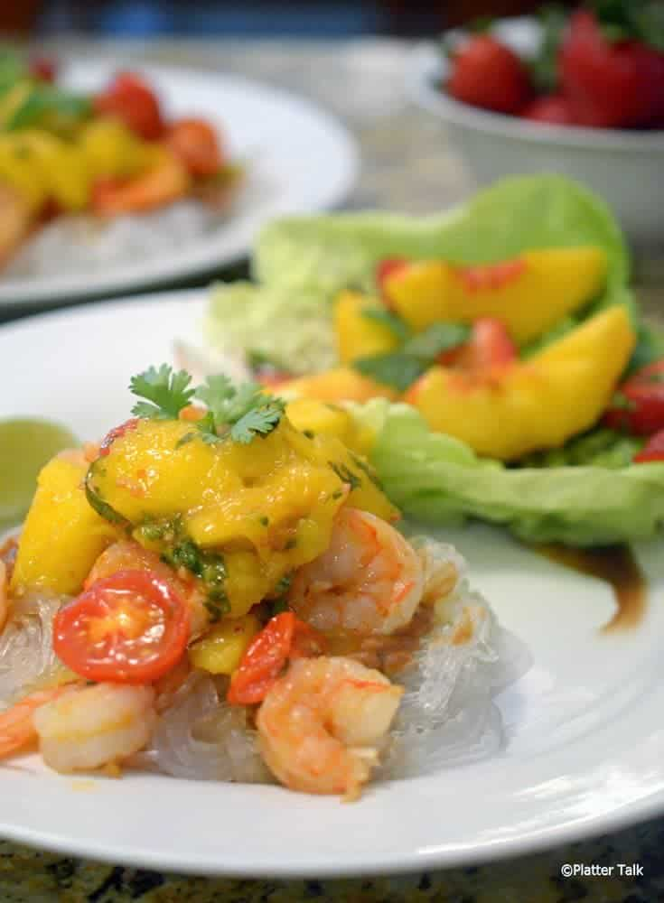 A plate of Asian shrimp and mango peach chutney