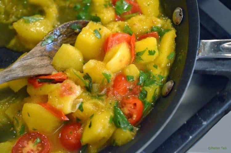 a pot of Asian shrimp with mango peach chutney