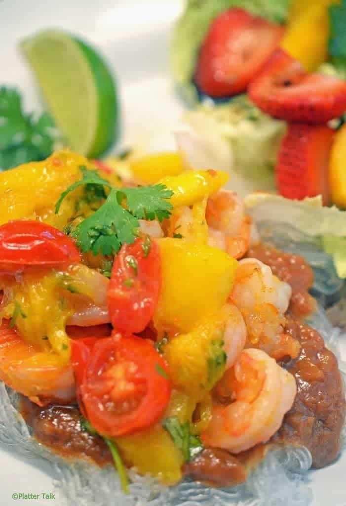 a close up of Asian shrimp and mango peach chutney