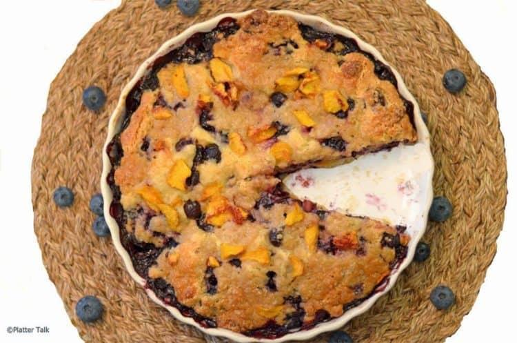 a dish of blueberry and peach yogurt streusel