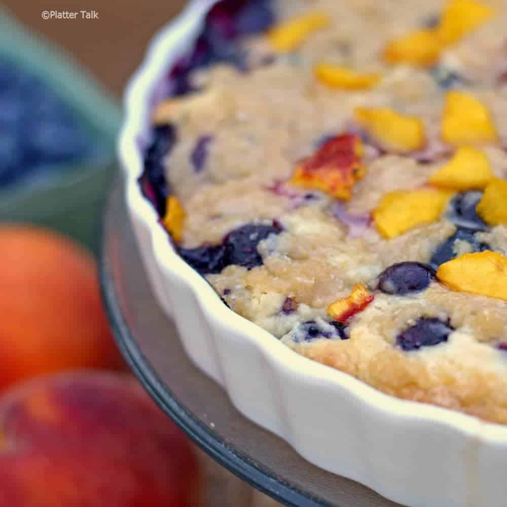 A close up of blueberry and peach yogurt streusel