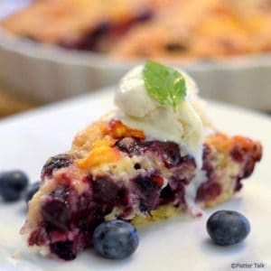 a slice of blueberry and peach yogurt streusel with ice cream