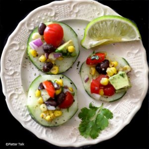 Cucumbers on a plate with salsa.