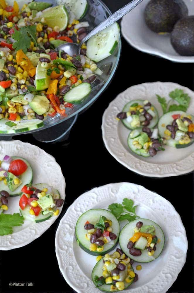 Slices of cucumber with corn salsa.