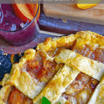 Peach pie with glass of sangria.