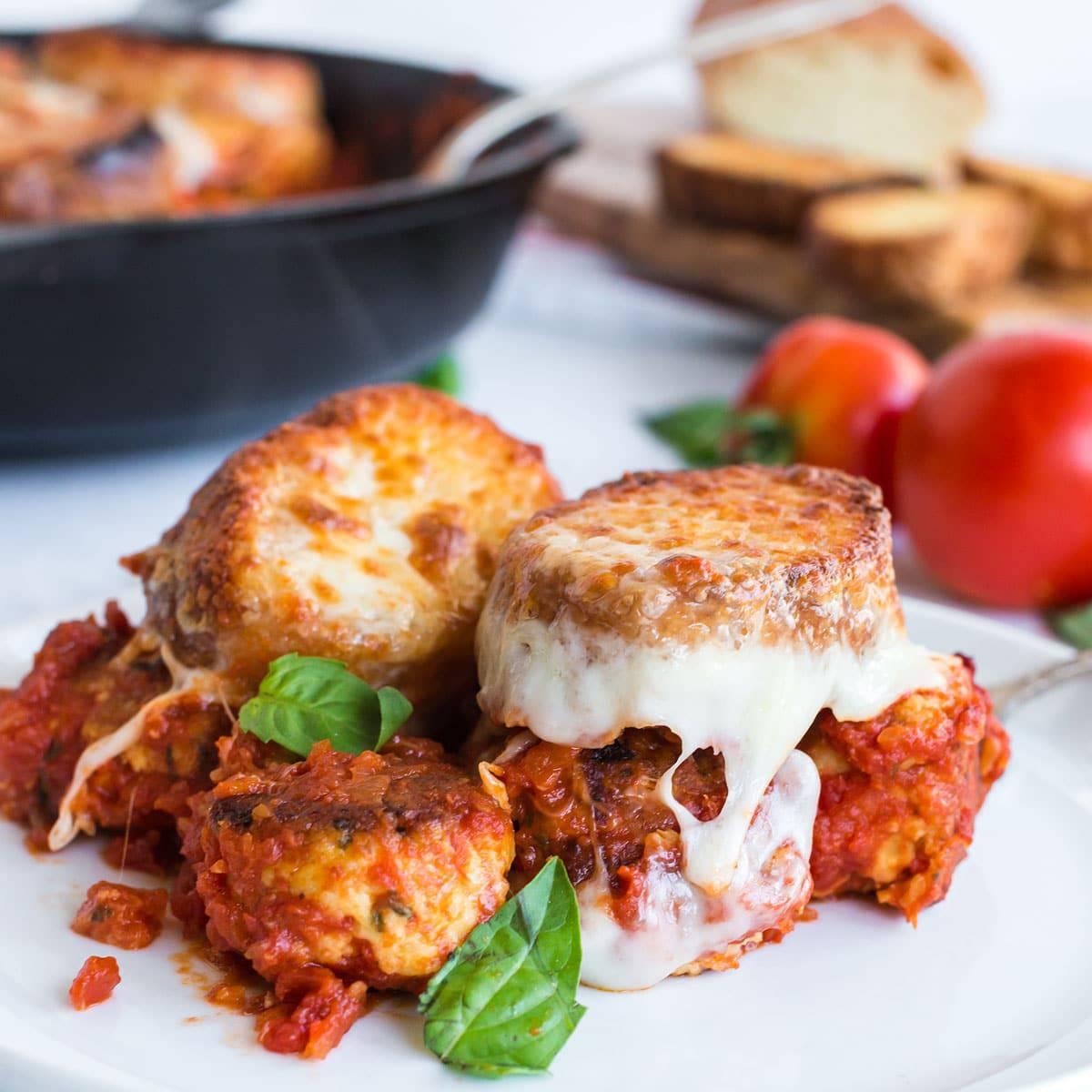 Plate of meatbasll sub casserole with basil garnish