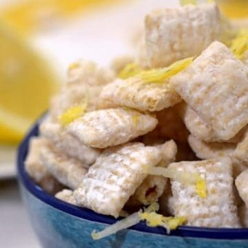 A bowl of food on a plate, with Lemon.
