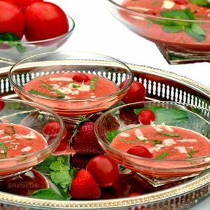A bowl of gazpacho on a table.