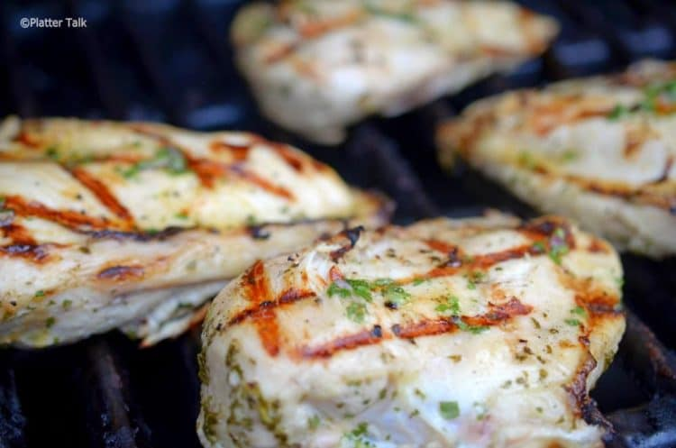 Chicken breasts on a hot grill.
