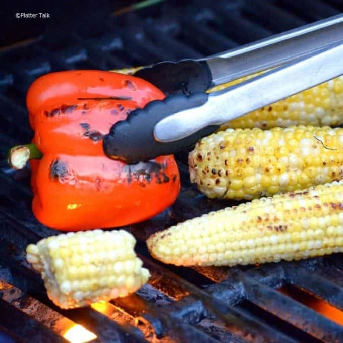 A roasted bepper and corn on the cob on the grlll