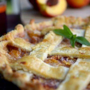 A close up of a peach pie.