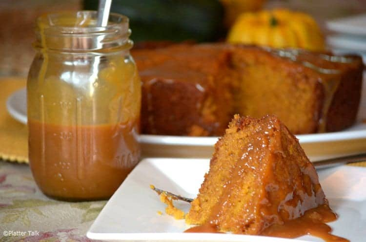 Pumkin cake slow, a crockpot dessert recipe on a plate with a jar of caramels sauce.