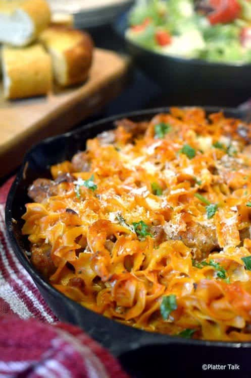 Noodles and sausage in a pan.