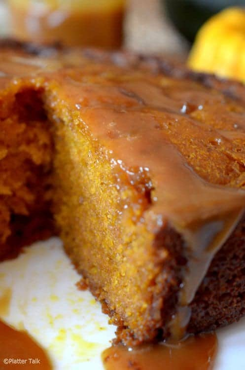 pumpkin cake with a slice cut out of it.