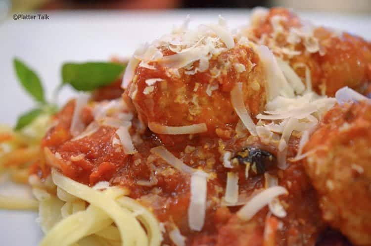 A close up of a plate of food, with Meatballs