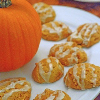 A plate of food on a table, with Cookie and Pumpkin