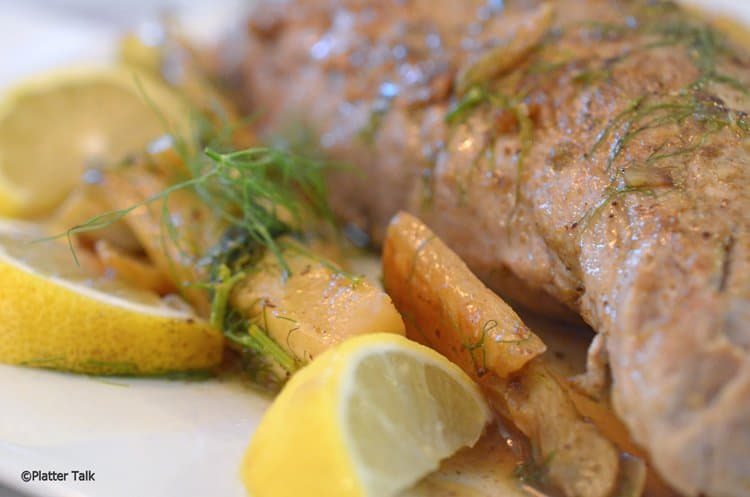 Roast fennel and garlic are added to pork tenderloing.