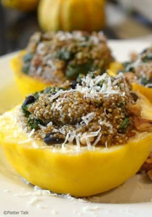quinoa stuffed squash recipe on platter talk food blog