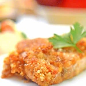 A breaded pork chop on a plate