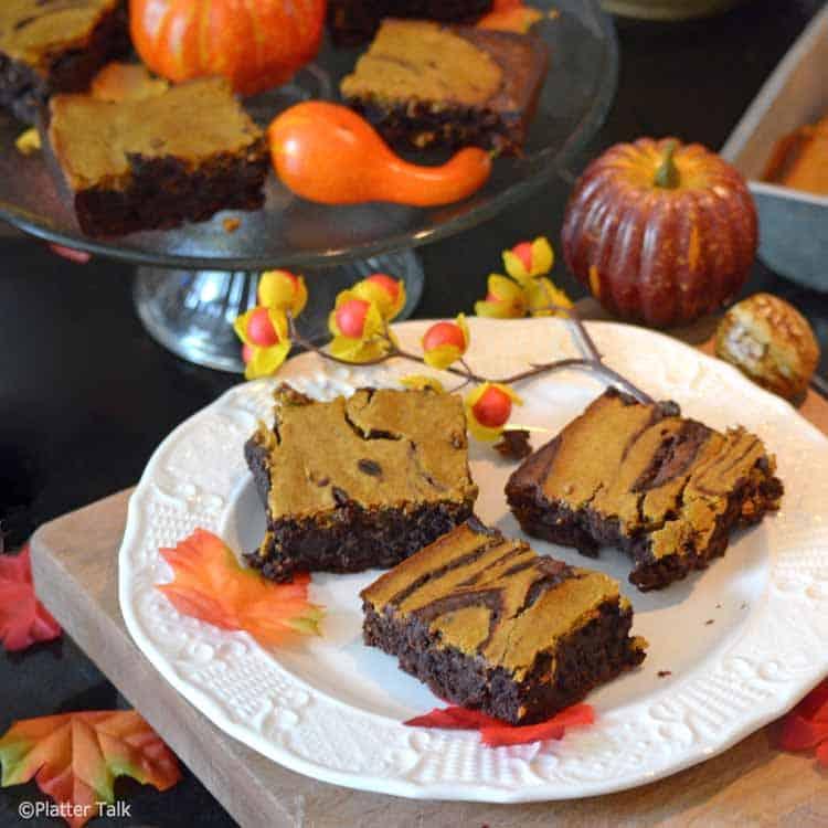 pumpkin cheesecake brownies on a platter.