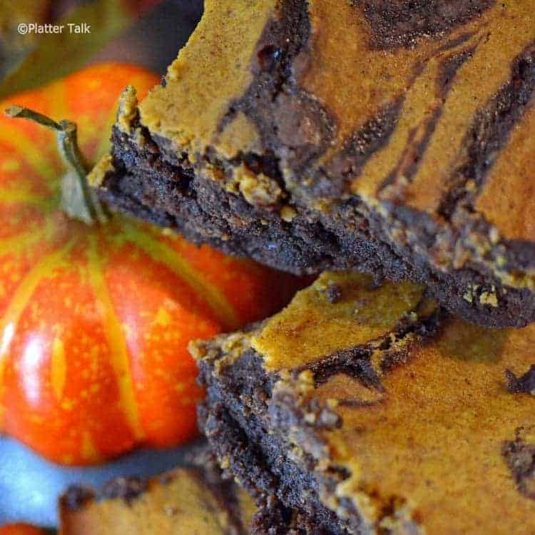 a close up of pumpkin cheesecake brownies.