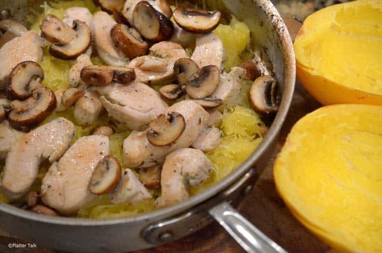 a pot of mushrooms and squash.